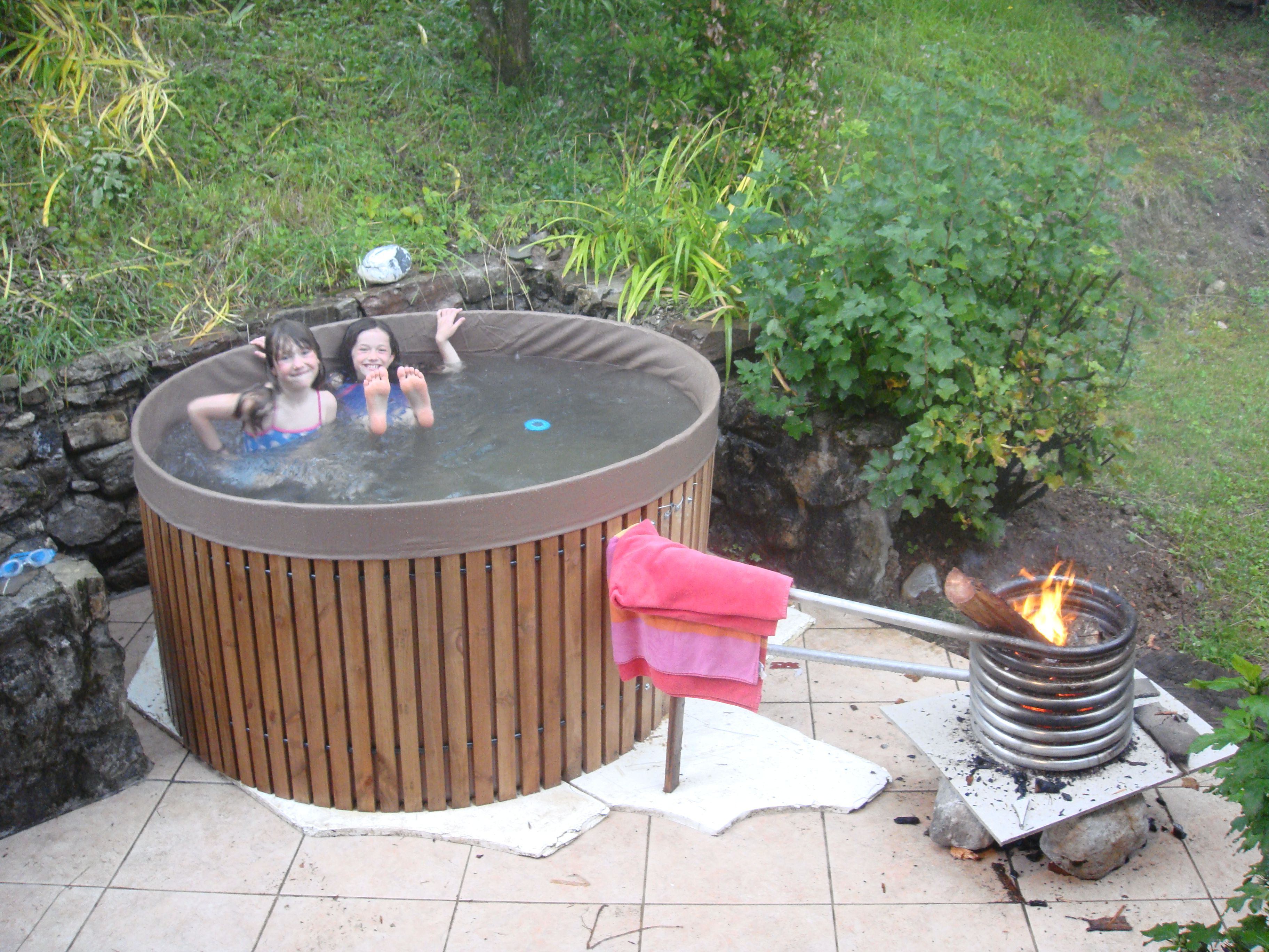 Diy hottub bath temp degrees in 4 hours just a wood fire inside pipe spiral hot water rises and draws in cooler water from below making thermal
