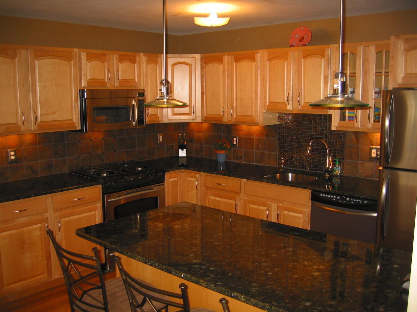 Oak Cabinets With Granite Countertops Pictures Uba Tuba Granite Countertops On Pinterest Granite Behr