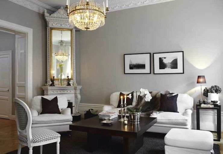 Chic Swedish living room with gray walls accented with crown - gray living room walls