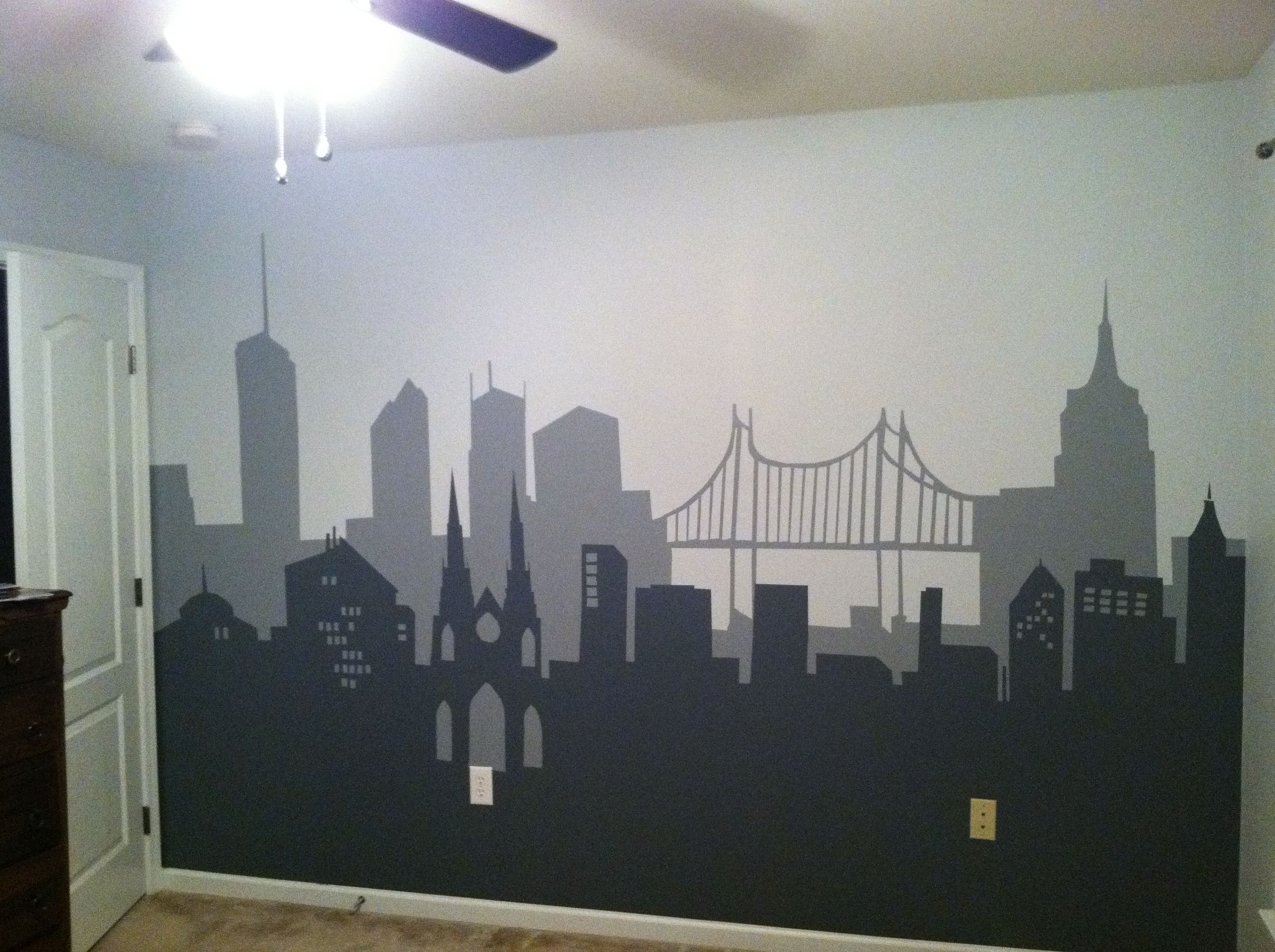 Batman bedroom i painted for son using clipart silhouettes painters tape and a craft projector