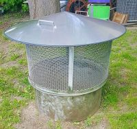 This is a free standing stainless steel fire pit with ...