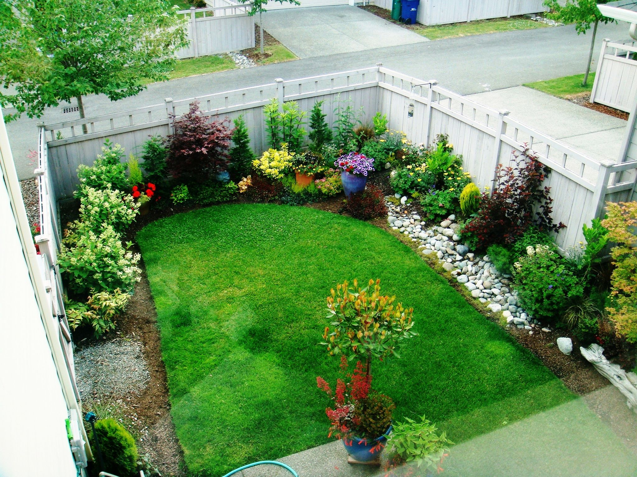 Small backyard garden this person didn t care for the grass and replaced it