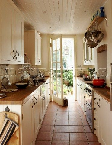 Galley kitchen with a door to a patio is the best! kitchen - small galley kitchen design
