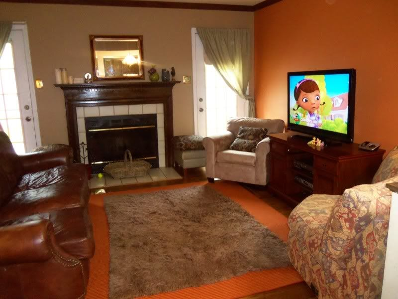 rooms with orange accent wall The Evolution of a Living Room - orange and brown living room