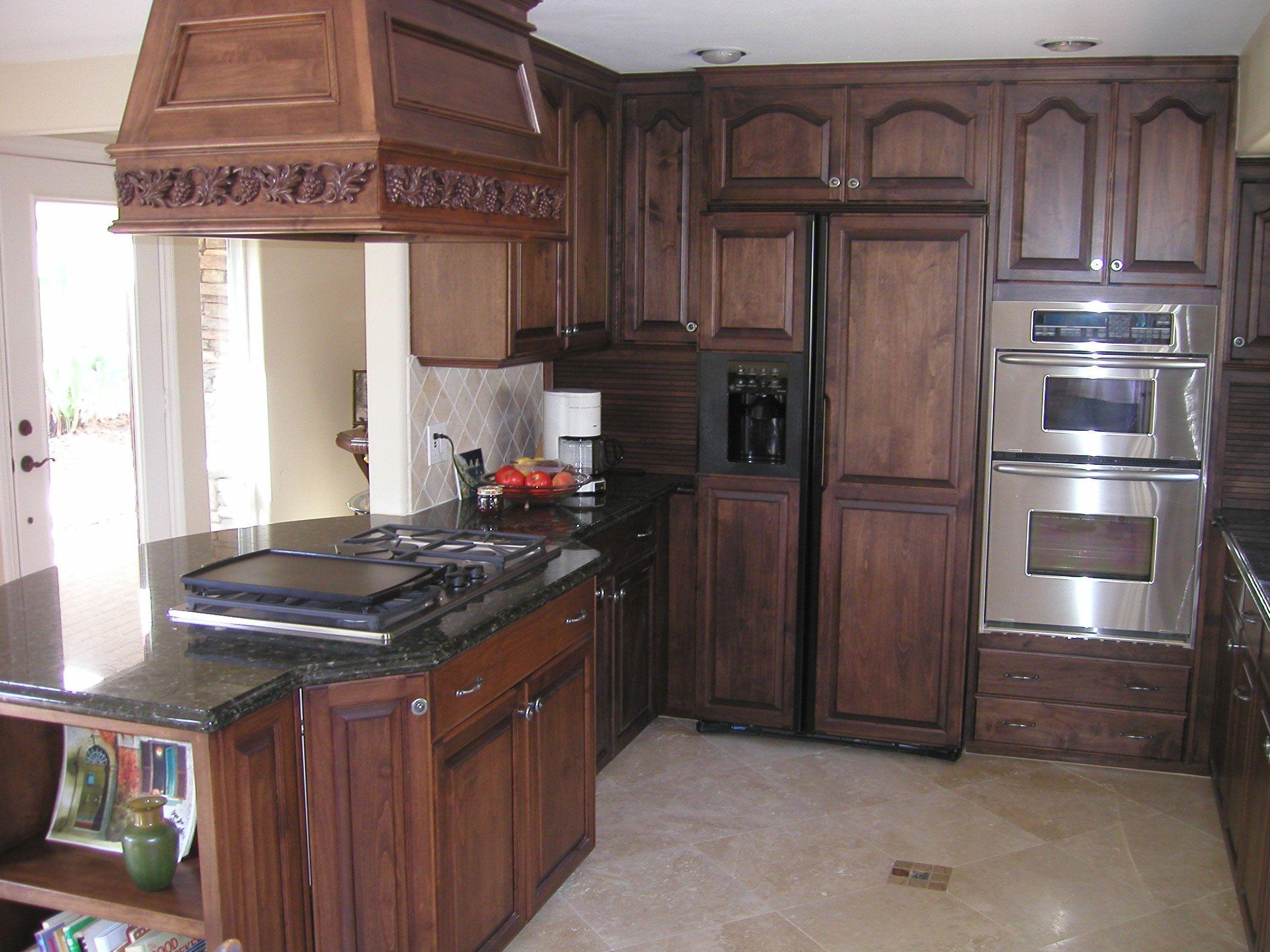 restaining kitchen cabinets a darker color restaining kitchen cabinets how to stain oak cabinets kitchen cabinets Stained dark oak and