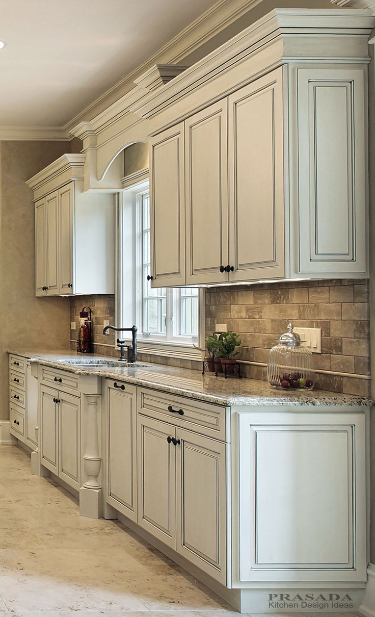 off white kitchen cabinets Classic kitchen Off white with clipped corners on the bump out sink granite countertop
