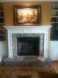 Stone fireplace with raised hearth | Fireplaces ...