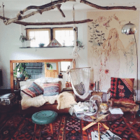 Southwestern rugs, fur, hung branches, rustic boho living ...