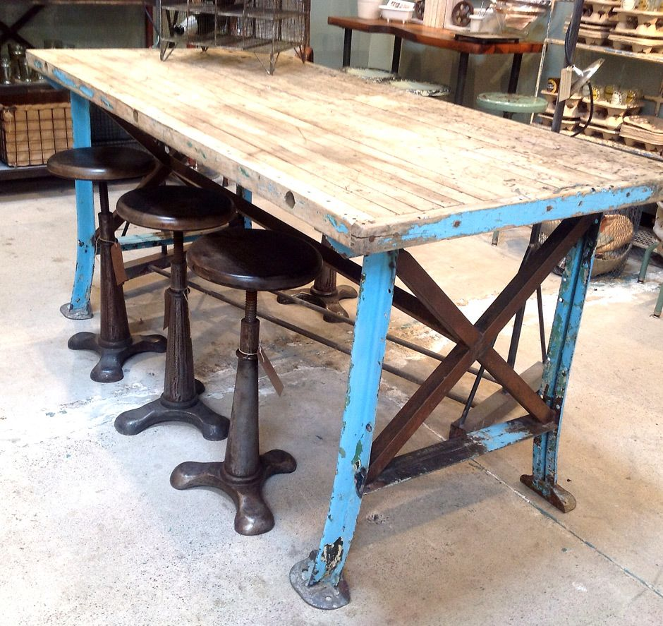 kitchen work tables Captivating Vintage Steel Table with Diy Tabletop from Reclaimed Barn Wood Planks Alongside Rustic Adjustable Bar Stools on Top of Precast Concrete Floor