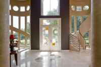 Contemporary Entryway with French doors, travertine tile ...