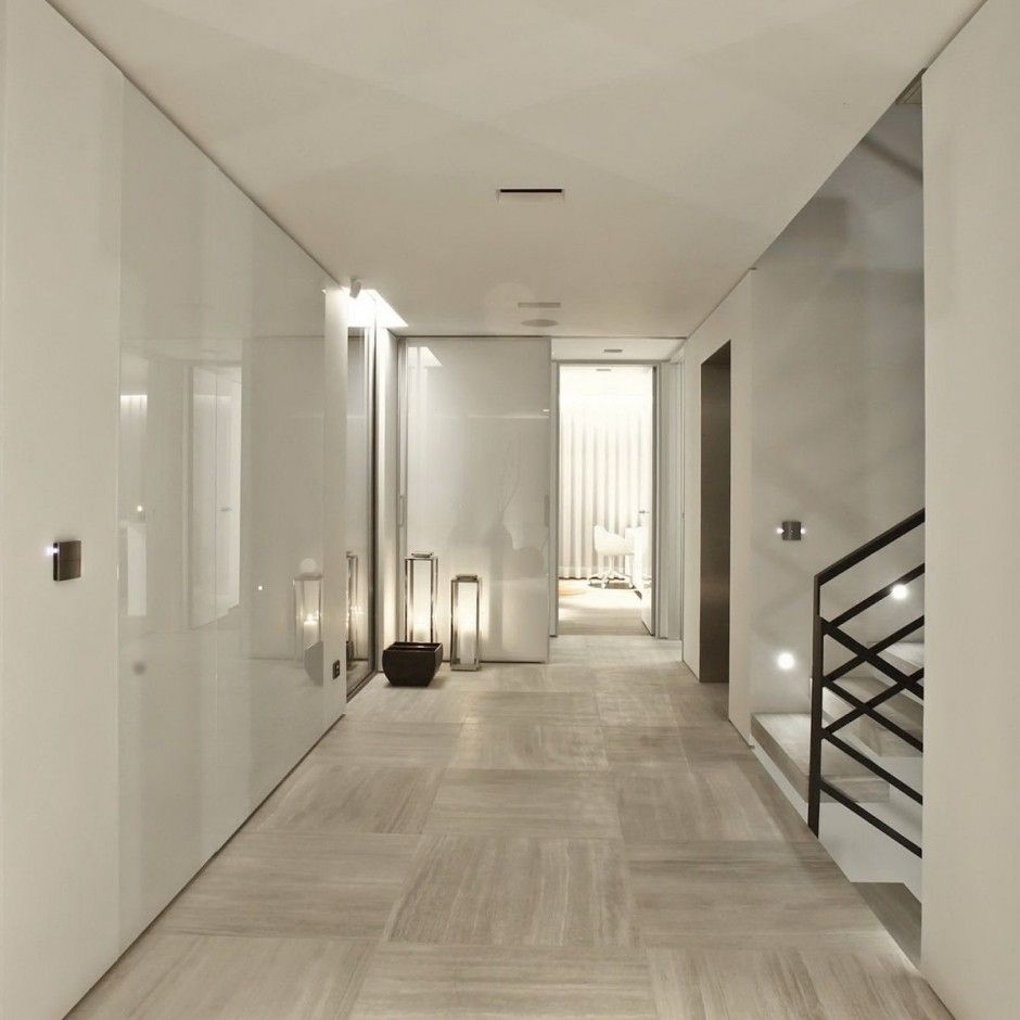 panels of glass perhaps? on white walls and stunning stone