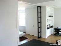 Use bookcase wall to support/accentuate pocket door ...
