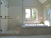 Built in tub next to shower with knee high wall in between ...