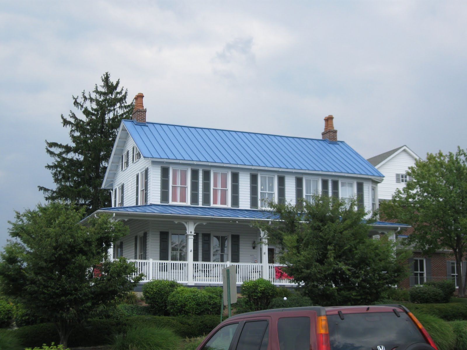 Farmhouse Exterior Colors With Metal Roof House With Blue Metal Roof Share One Day