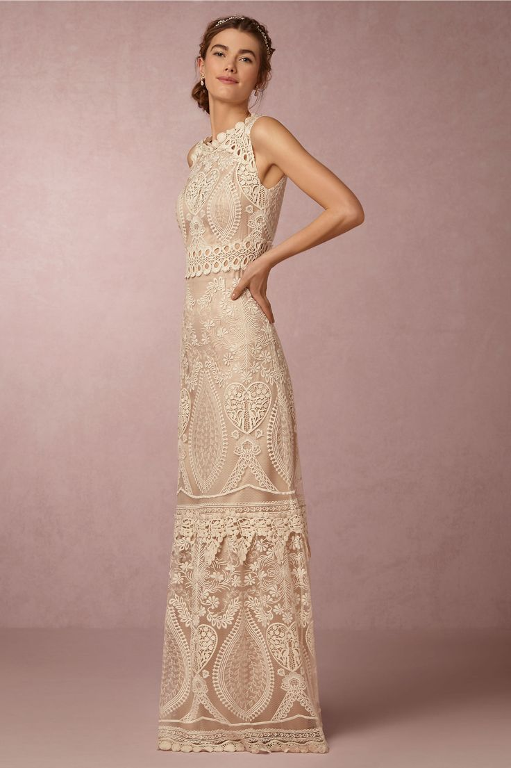 heart shaped wedding dress Lace wedding dress with heart shaped embroidery details peekaboo lace at the waist