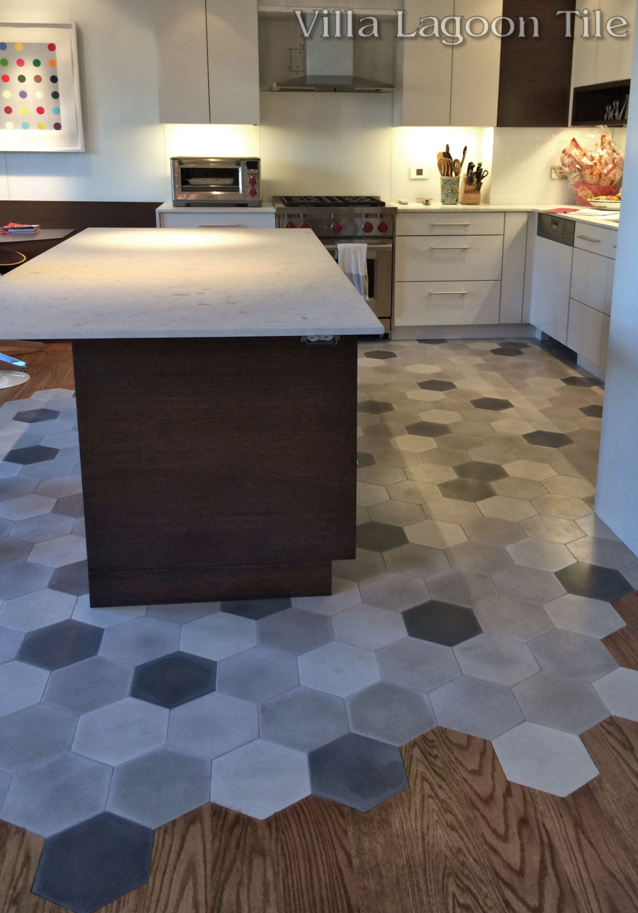 wood floor kitchen This beautiful New York City installation flows hardwood floors into our mixed gray hex cement tile