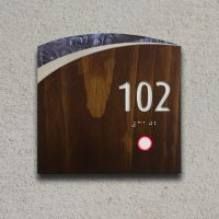 Custom hotel room number sign with solid wood shell with ...