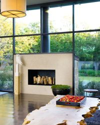 Modern fireplace surrounded by windows.   Fireplaces ...