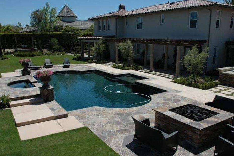 Stunning backyard with pool, hot tub, covered patio and