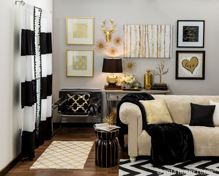 Make a grand statement with metallic gold and black home accents - black white and gold living room ideas