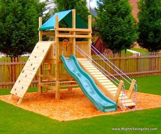 A slide, rock wall and draw bridge - just needs a firemanu0027s pole - home playground ideas