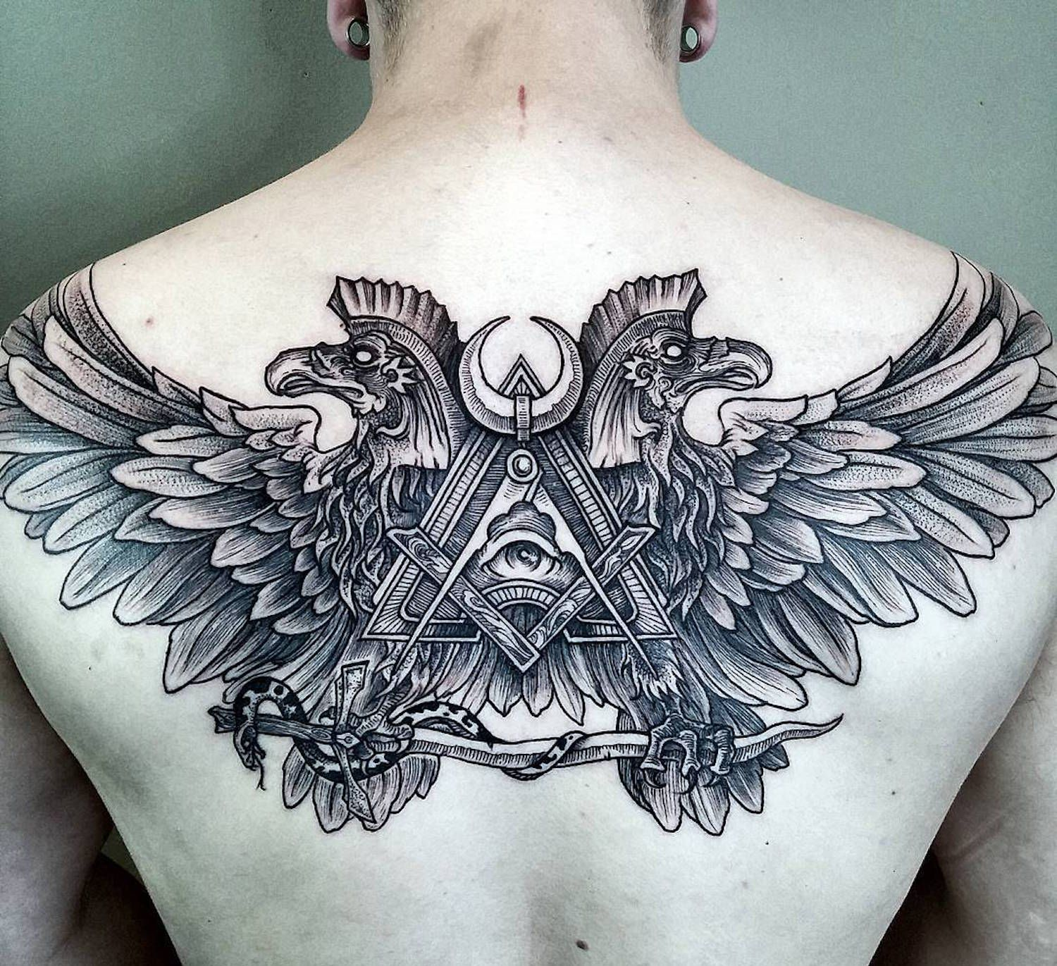 Back tattoo design ideas for men by phil tworavens