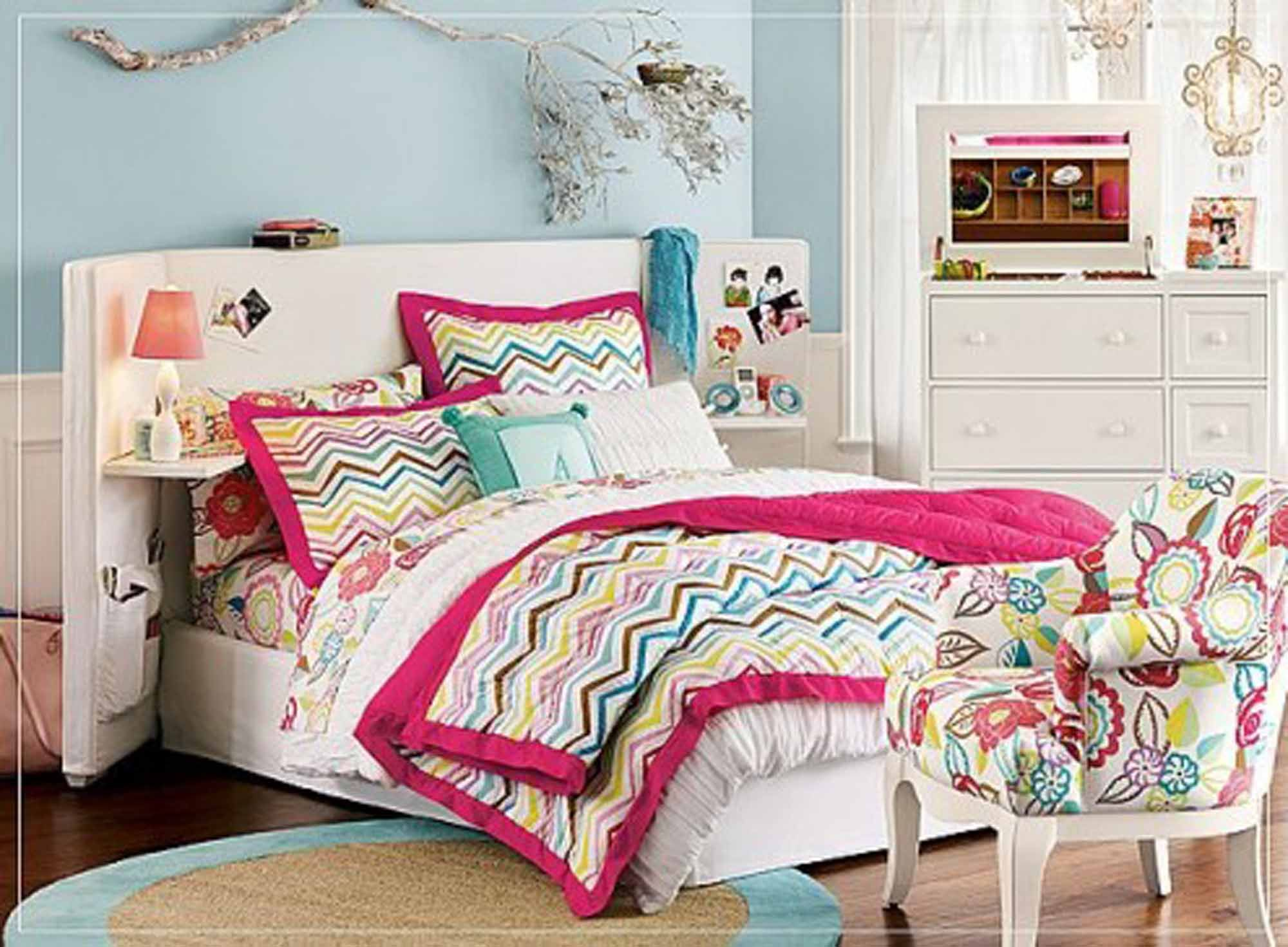 Beautiful teenage girl bedroom decorating idea with queen bed frame and floating shelves and colorful chevron