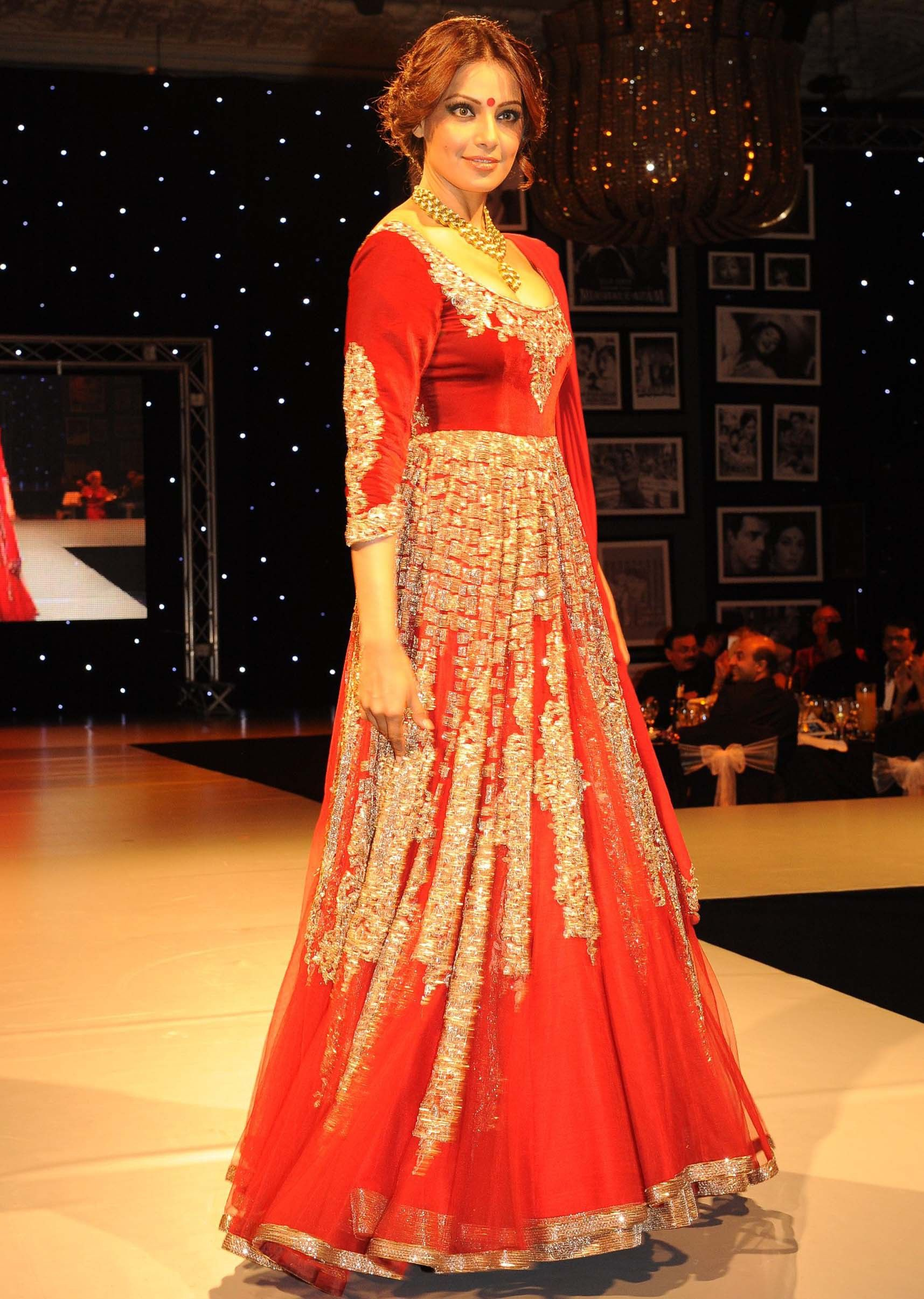 Bipasha basu in red dress walking the ramp for manish malhotra festive collection in london