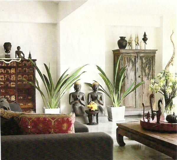 Home Decorating Ideas with an Asian Theme Armoires, Plants and - living room statues