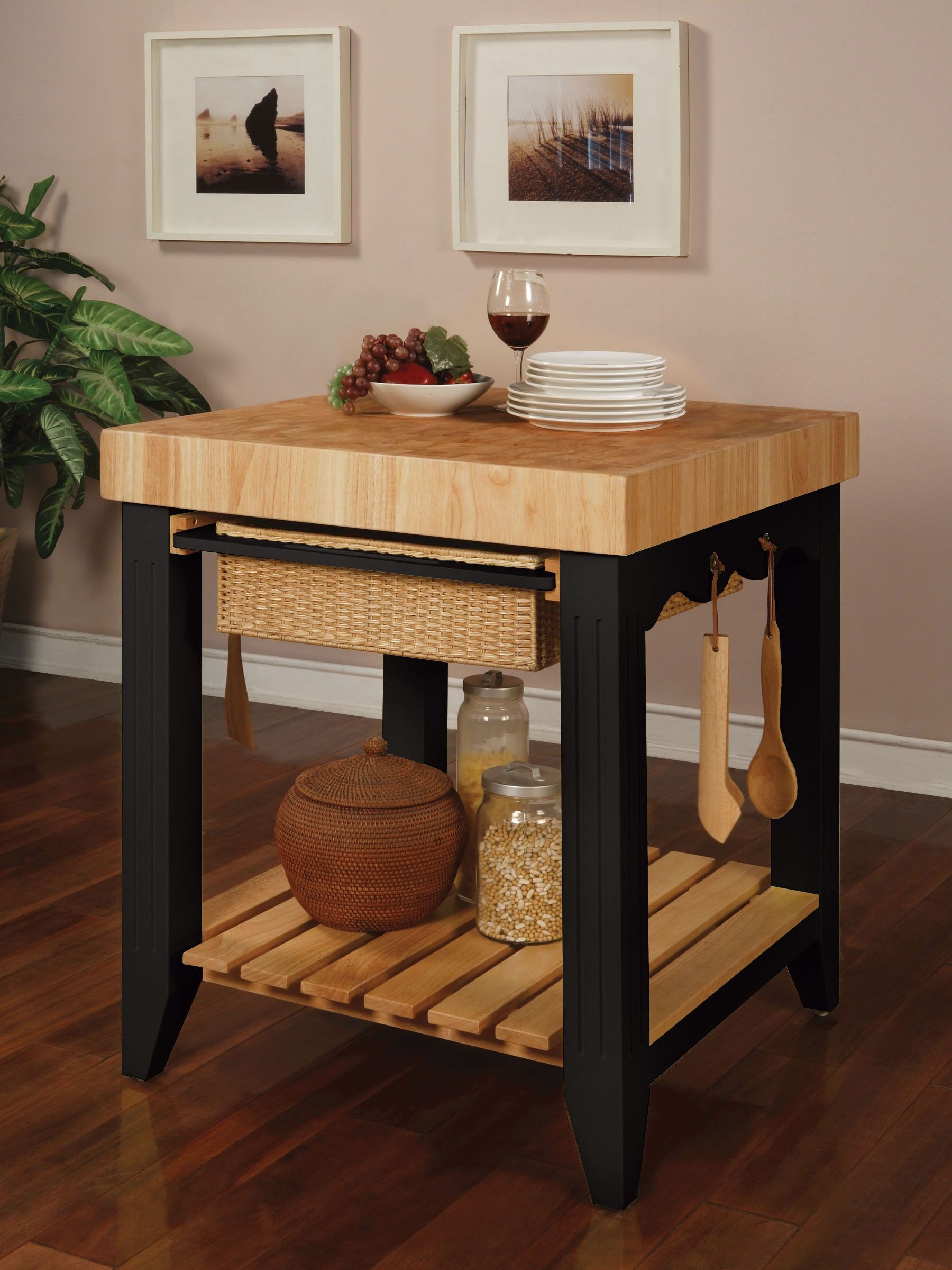 White kitchen island with butcher block top and 4 legs black wooden butcher block with natural