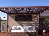 Outdoor pergola with laser cut feature roof panels by ...