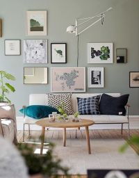 Gallery wall decor in a modern living room featuring warm ...