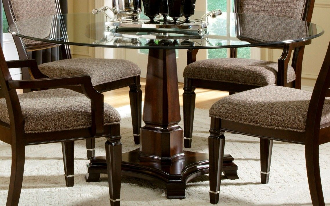Awesome classic brown varnished wooden dining table base with rounded glass top