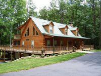 Modular cabin with split log siding by Nationwide Homes ...