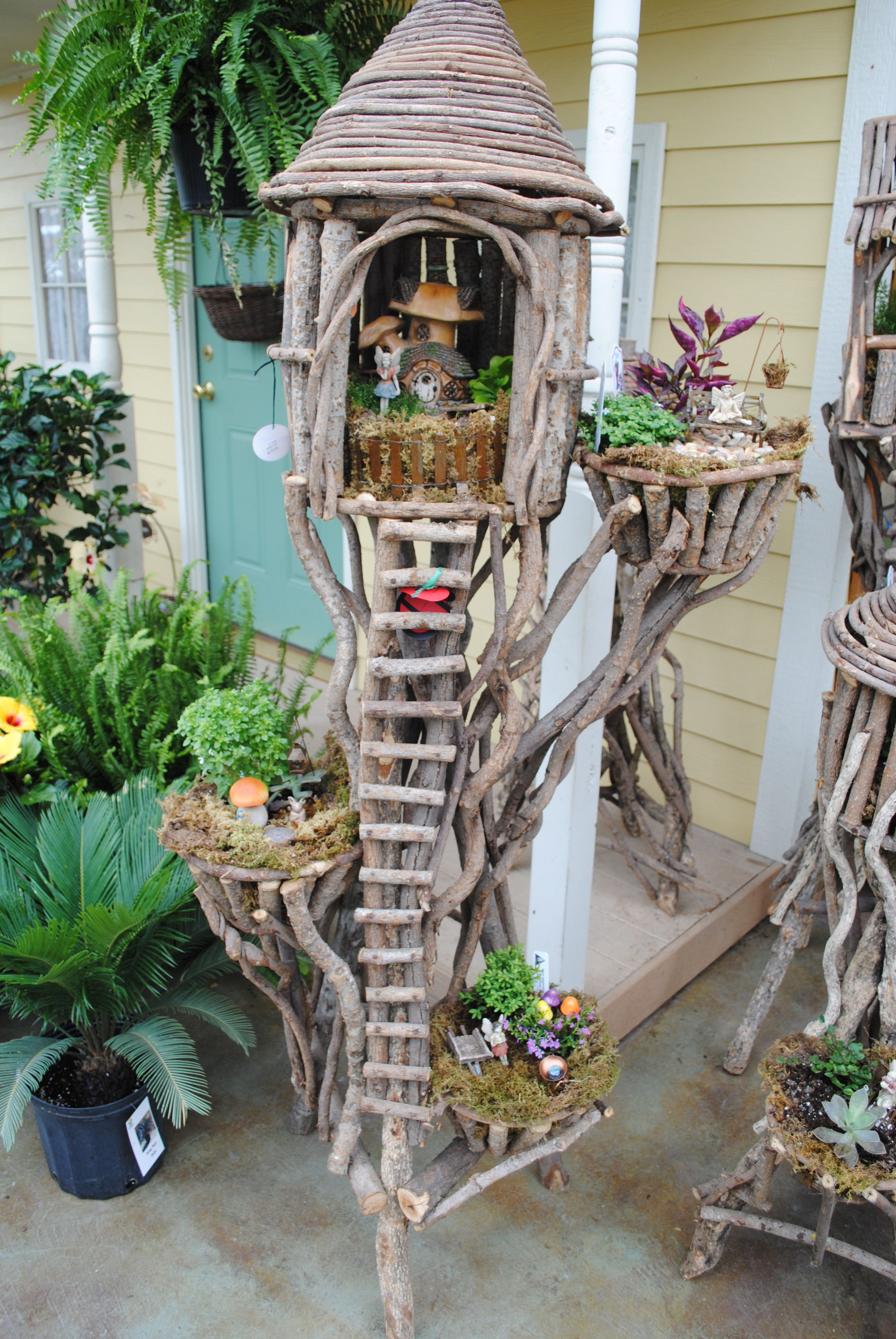 I have so much driftwood i should assemble a fairy tree house like this inspiration