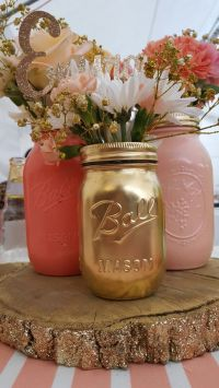 Baby shower centerpieces. glitter covered logs, mason jars ...