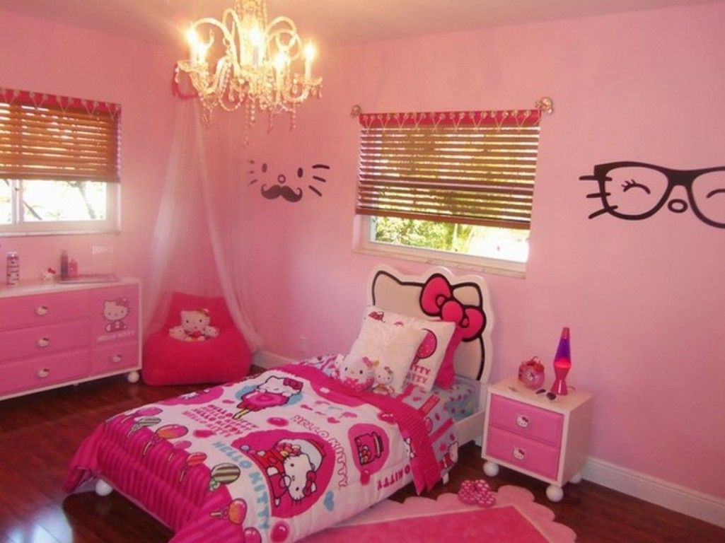 Amazing bedroom decor with unique pendant light above hello kitty bed design and pink wall paint color also using bamboo curtains for glass window