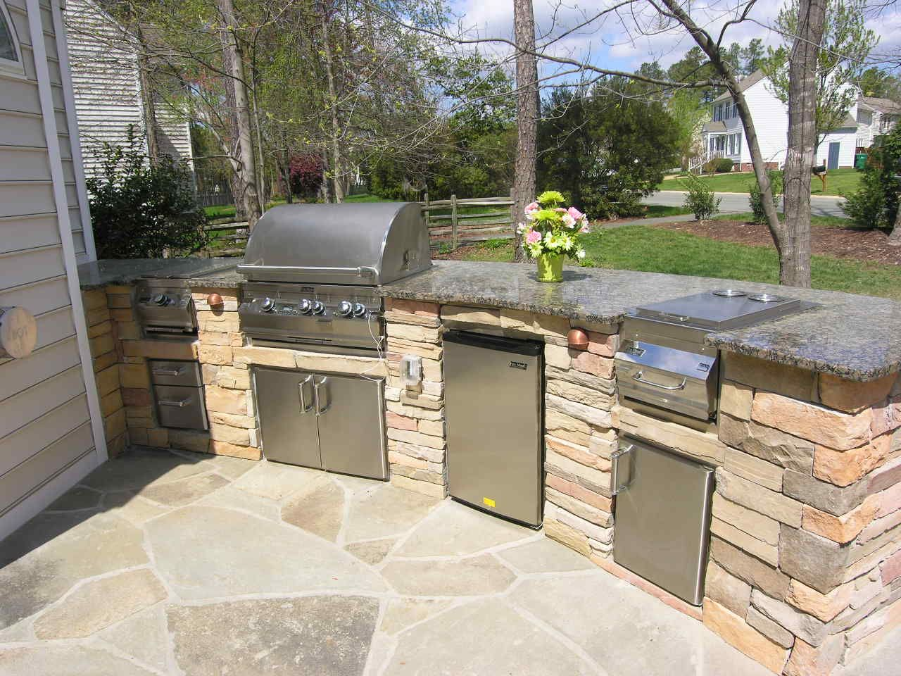 outdoor kitchen ideas backyard patio with kitchen ideas This custom outdoor kitchen design has space for several outdoor