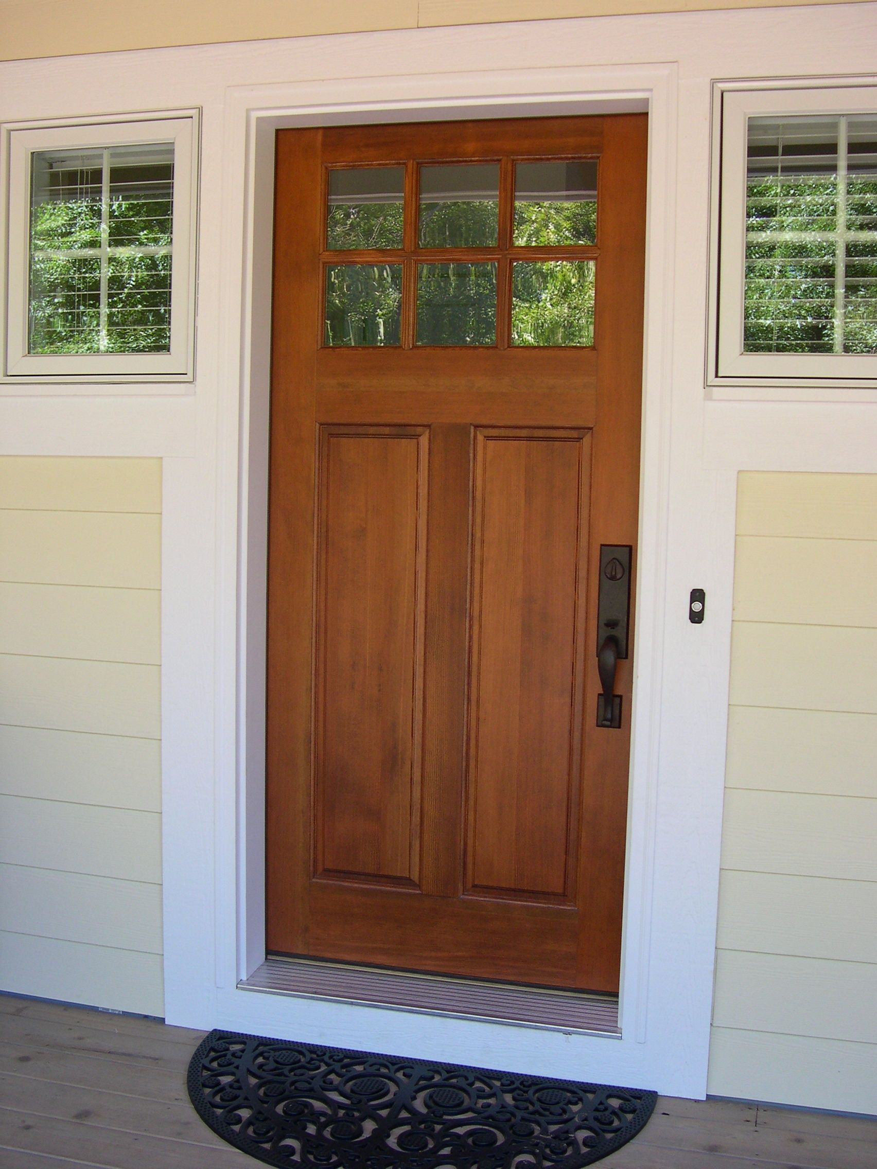 Front entry, cottage style stained front door.