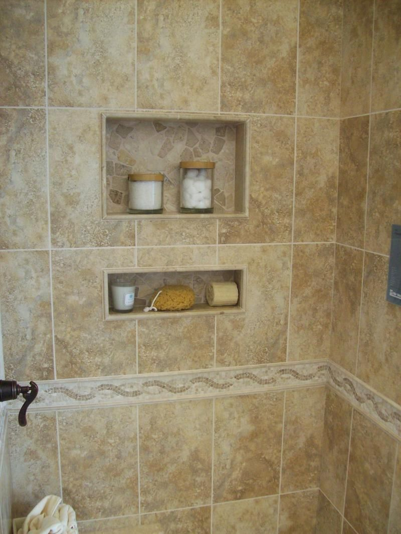 A ceramic tile shower with 2 inset shelves in a bathroom in minneapolis mn