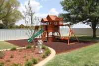Rubber mulch in home playground and landscape surfacing ...