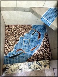 blue ceramic tile shower floor with fish tiles