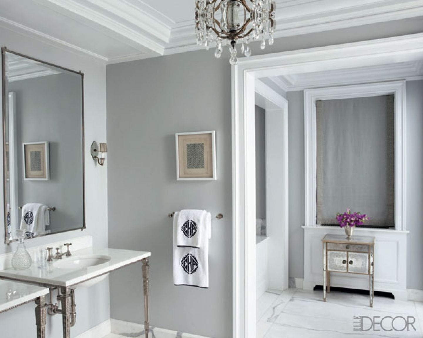 Elegant bathroom paint idea with grey painted wall and white borders also two sink consoles with