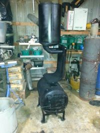 Homemade wood burning stove made from an old water heater ...