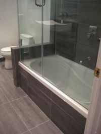 black bathroom with wooden pattern tiles carrying drop in ...