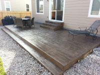 Wood-grain texture stamped concrete patio & steps | Casco ...