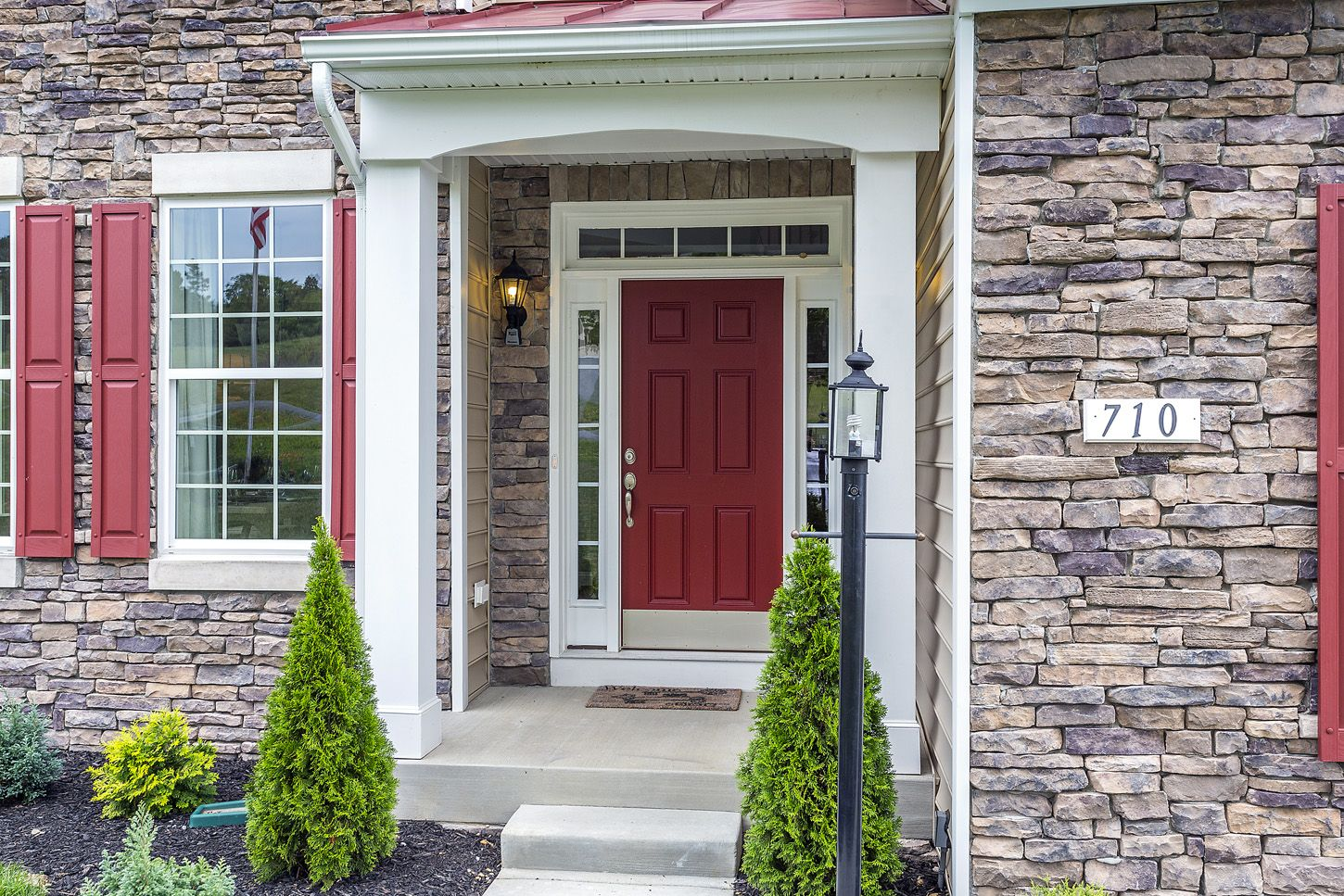 Beautiful Doors For Homes Beautiful Model Home With Stone Siding Red Shutters Red