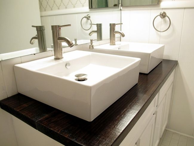 White Vessel Sinks And Stained Wood Countertop Live The