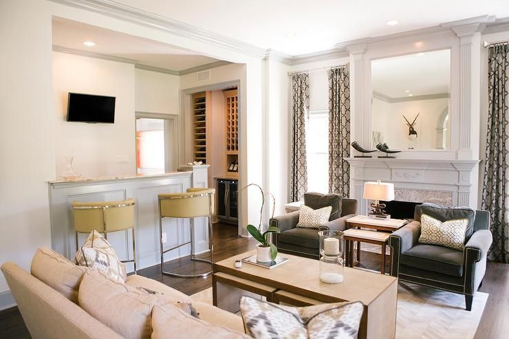 Chic living room features a natural linen sofa facing a pair of - living room bar furniture