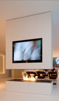Contemporary home with TV on the top of modern fireplace ...